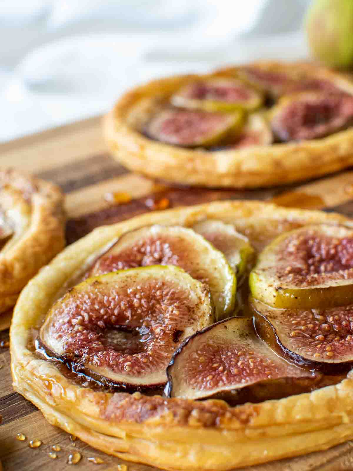 close up of slices of fresh figs baked on puff pastry.