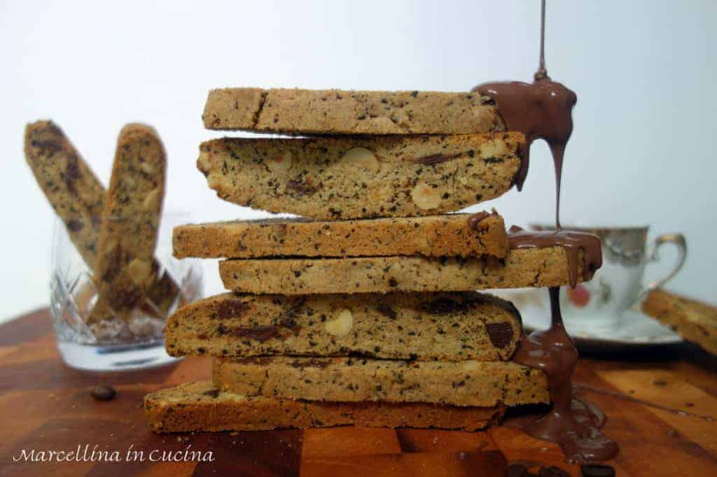 stack of espresso and hazelnut biscotti with chocolate dripping onto the biscotti