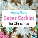 Sugar cookies in the shape of a snowflake covered with white and coloured fondant