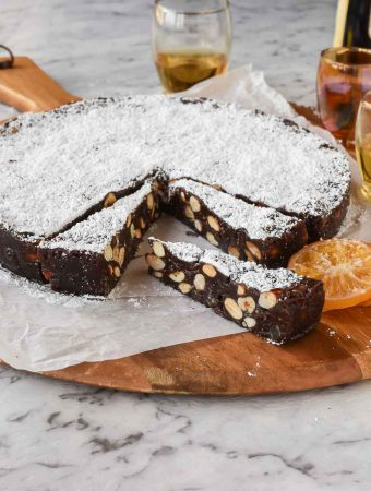 round cake of panforte with a few slices cut