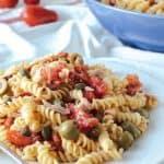 Italian pasta salad on white plate