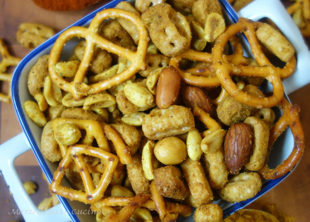Spicy crunchy savoury snack of nuts, pretzels and crunchy cereal