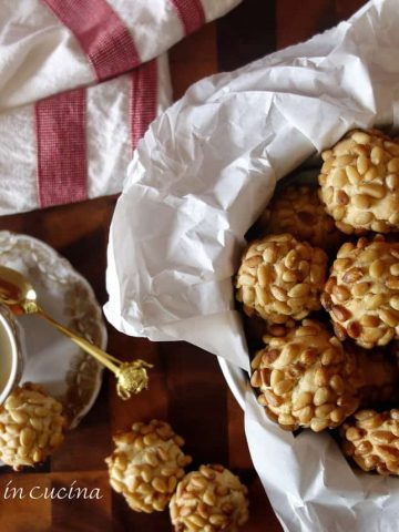 Italian Pignoli cookies in cookie tin with espresso in vintage white and gold cup