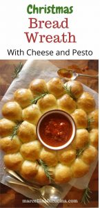 top image wreath made of bread with tomato dipping sauce in the middle.