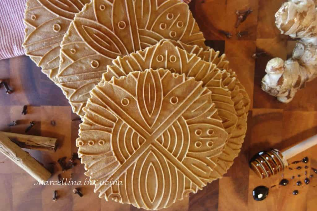 Gingerbread Pizzelle with cinnamon sticks, whole cloves, fresh ginger and molasses on a stick