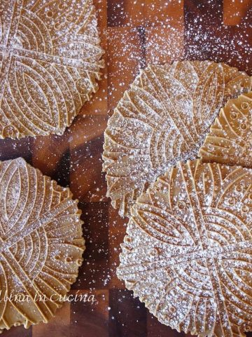 Gingerbread Pizzelle dusted with powdered sugar