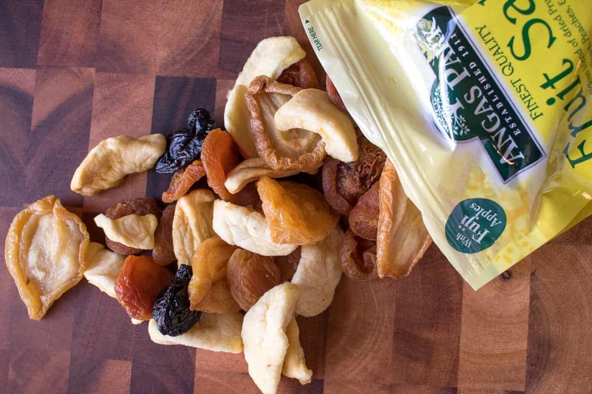 Mixed dried fruit spilling out of packet