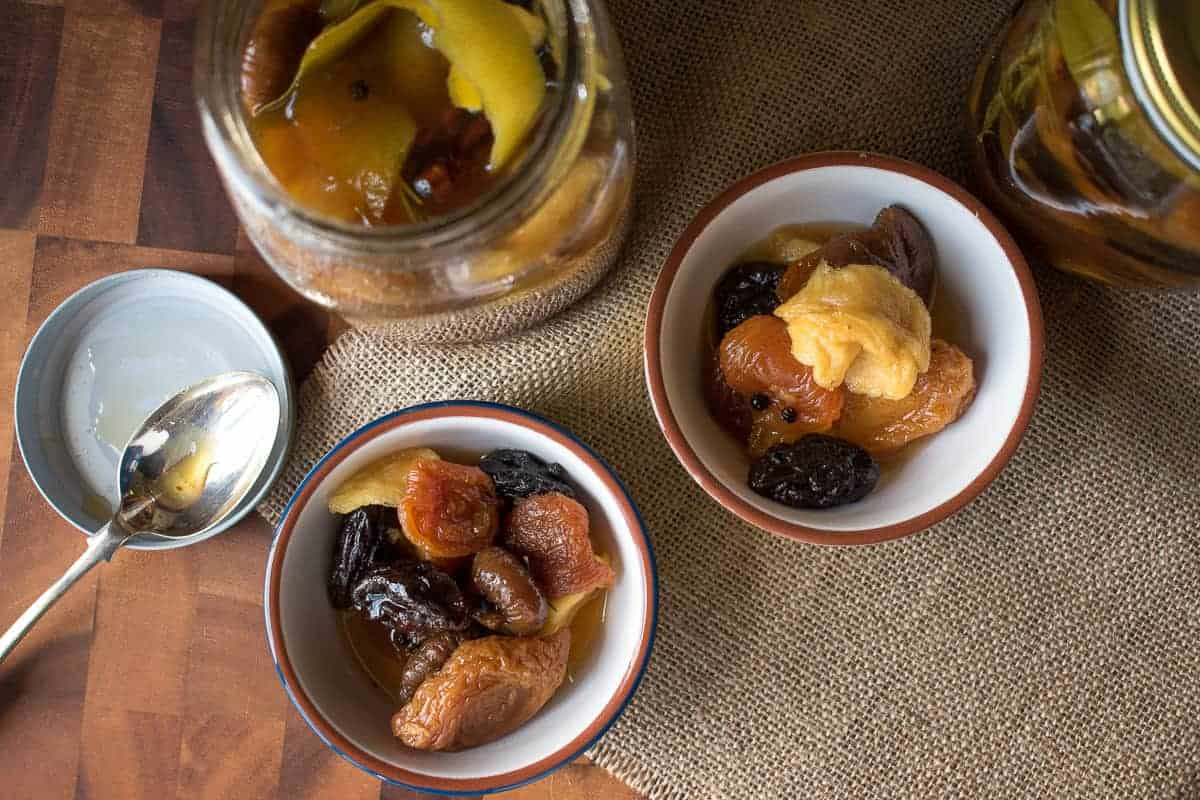 Two bowls of Spiced Dried Fruit with Rum and open jar