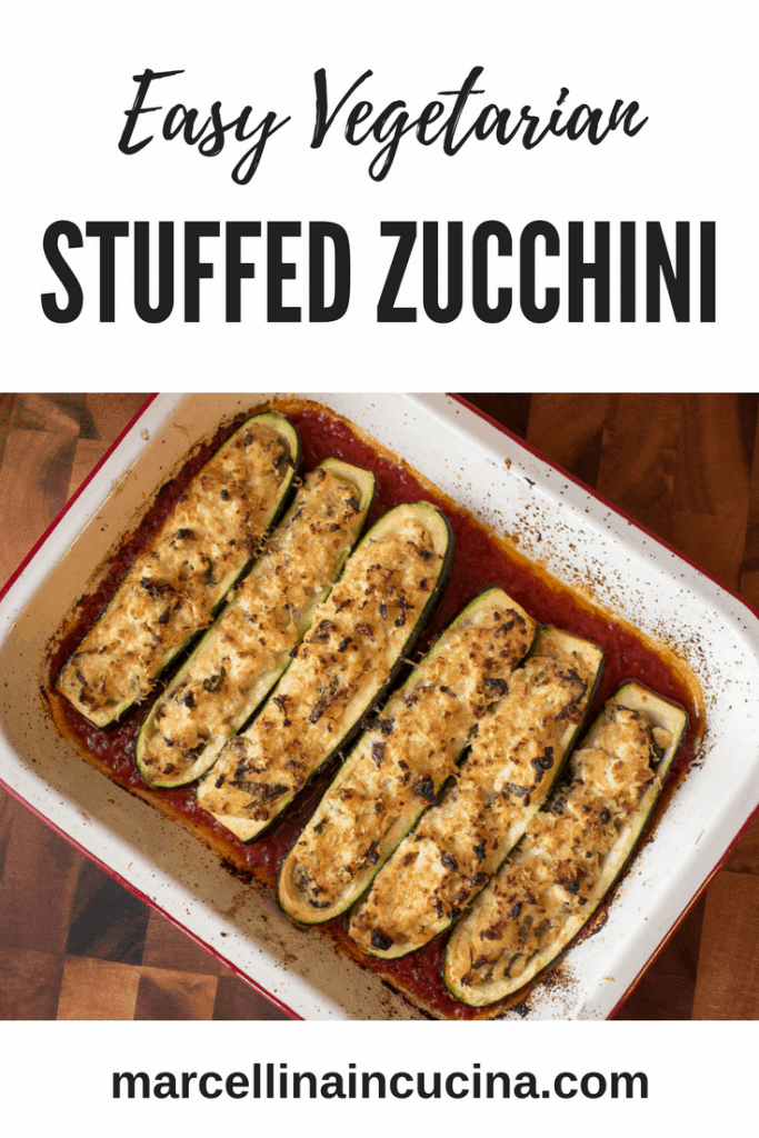 Baking tray with six Stuffed Zucchini halves with Ricotta in tomato sauce pin