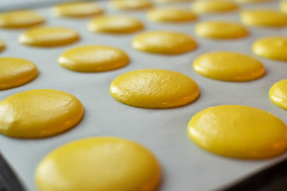 Yellow macarons ready for baking
