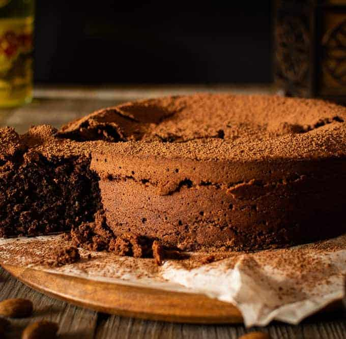 chocolate almond cake with a slice cut