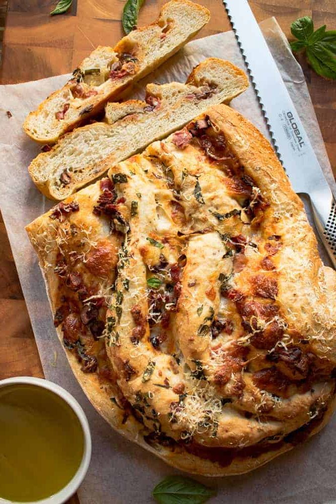 Baked Pizza Bread with two slices cut