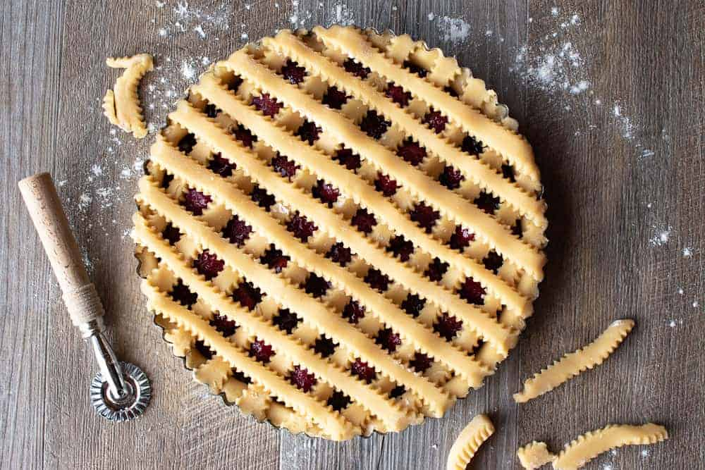 Top of unbaked strawberry crostata recipe with pastry lattice work