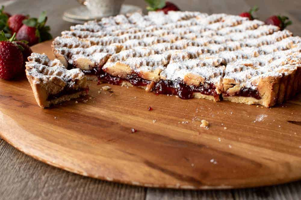 Strawberry crostata recipe cut with jam oozing
