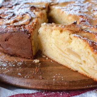 Apple cake with a slice cut