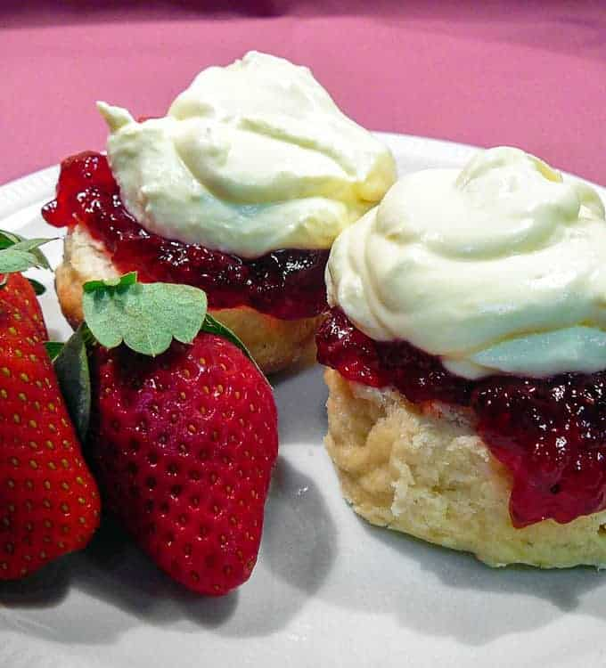scones with jam and cream and strawberries