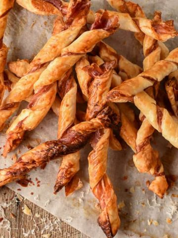 pile of puff pastry twists with prosciutto and parmesan