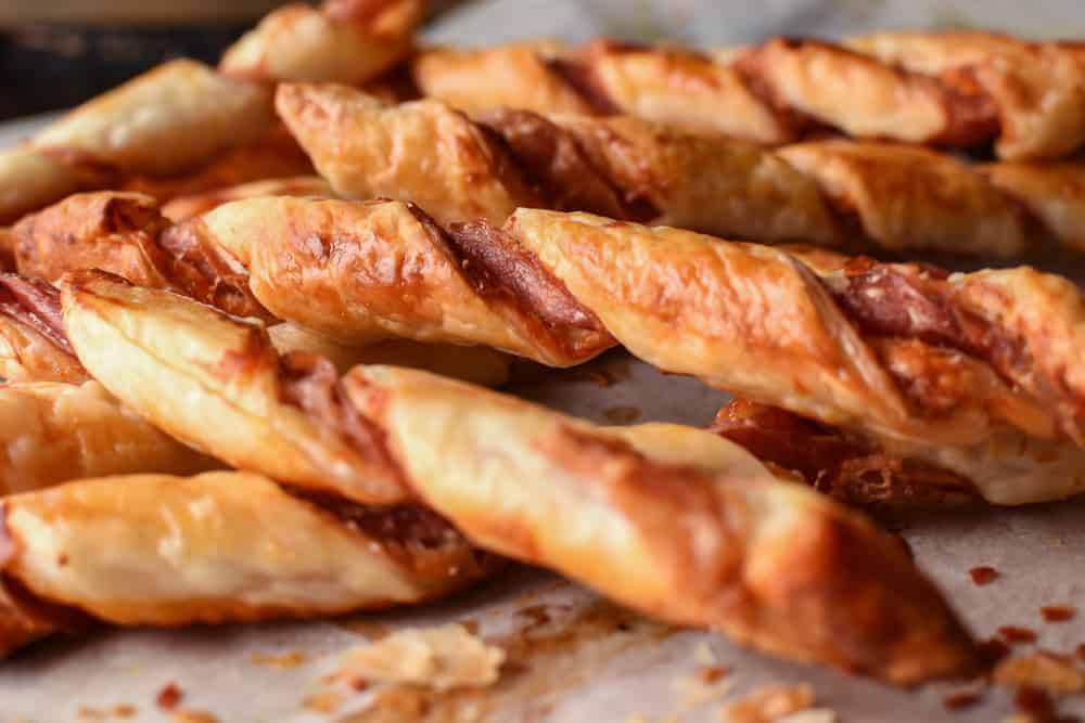close up of puff pastry twists with prosciutto and parmesan
