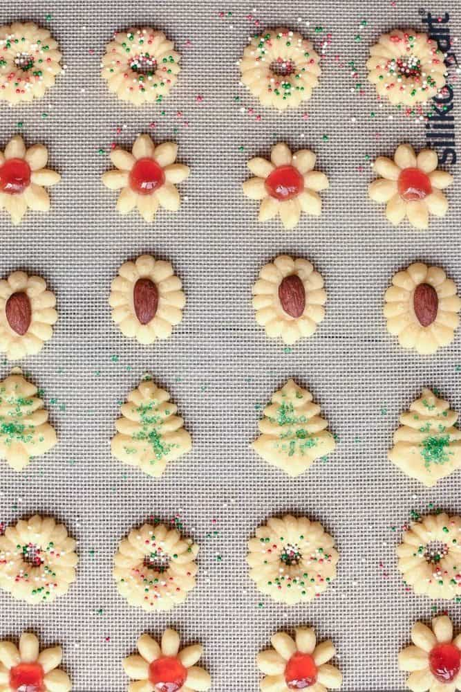 different varieties of spritz cookies ready for baking