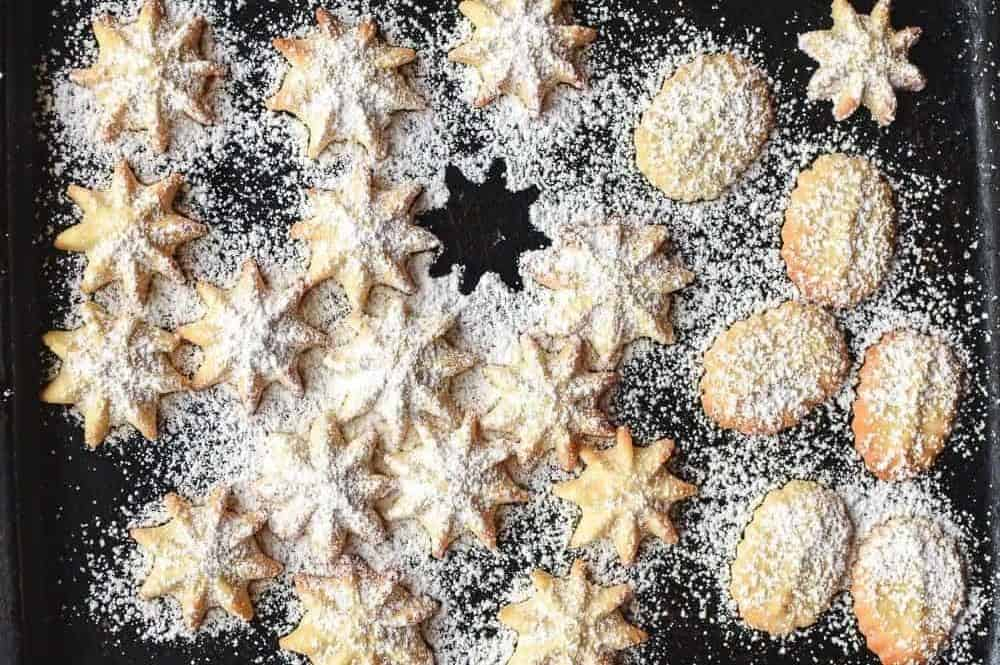 spritz cookies dusted with powdered sugar