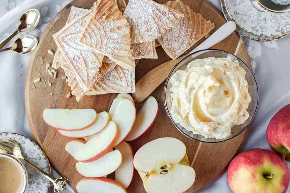 sweet ricotta on a board with apple slices and pizzelle