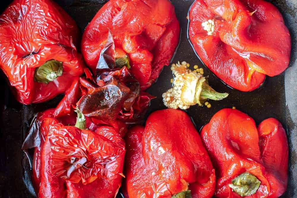 Whole roasted red peppers viewed from above.