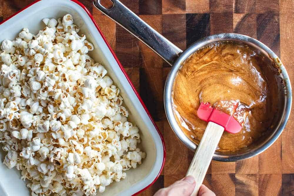 Pan of caramel and tray of popcorn, overhead