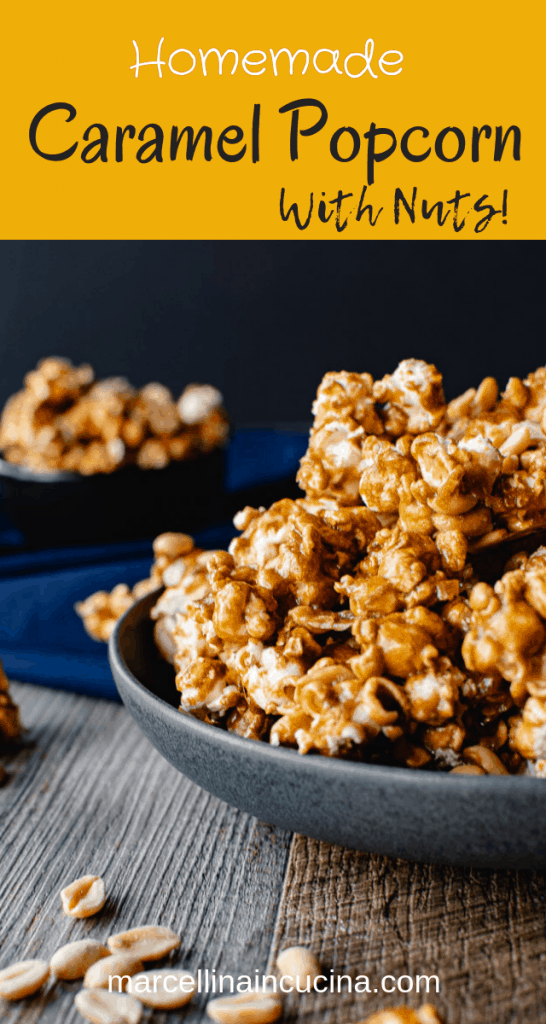 Homemade caramel popcorn in a grey bowl on blue cloth. smaller black bowl of caramel popcorn in background caramel popcorn and nuts on wooden table. close up