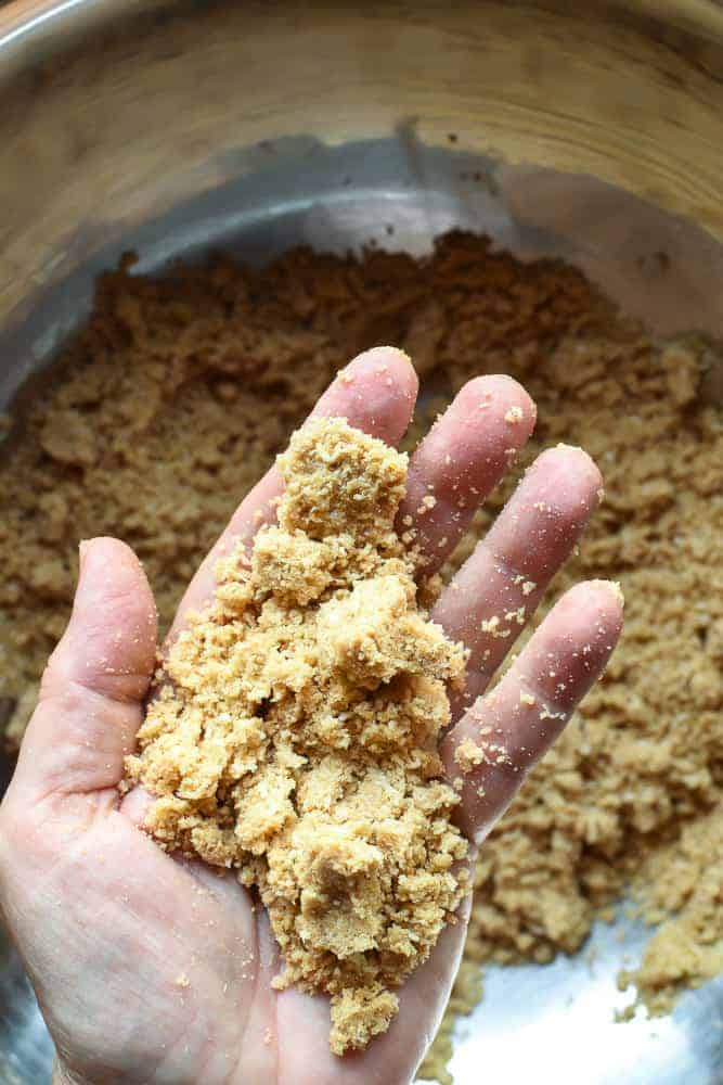 open hand holding crumble mixture
