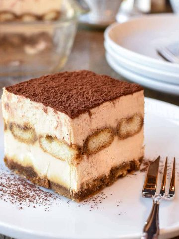 square slice of tiramisu on white plate