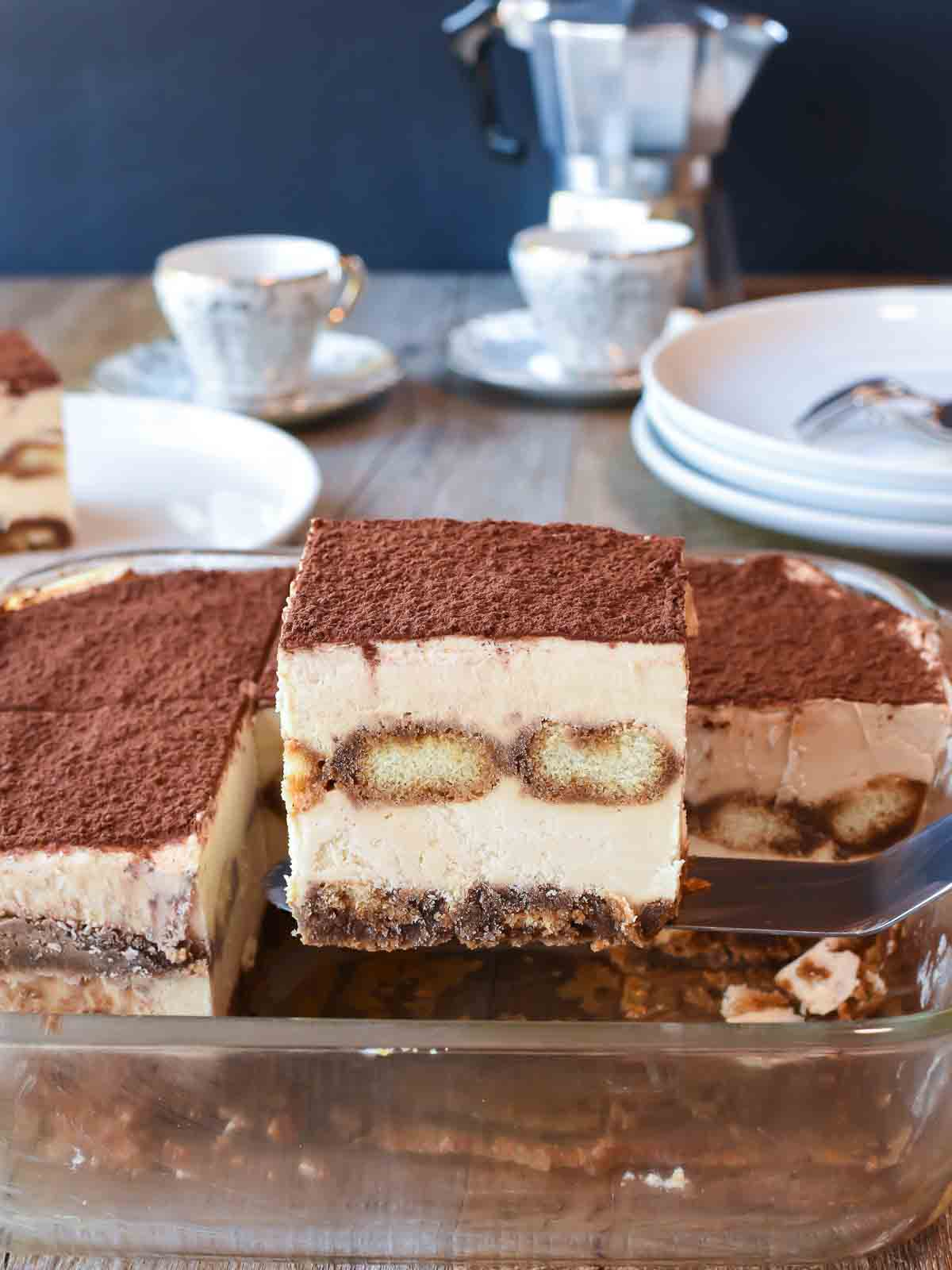 square slice of tiramisu lifted from serving dish