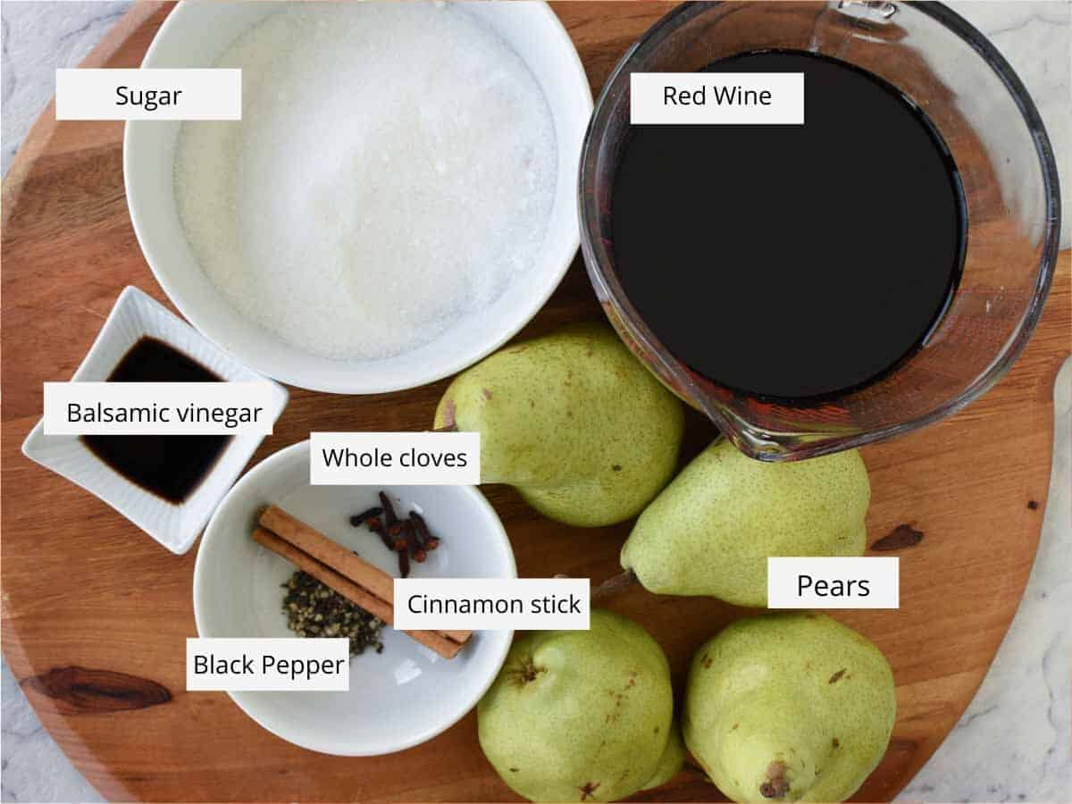 Ingredients for poached pears in red wine - sugar, red wine, green pears, spices, balsamic vinegar