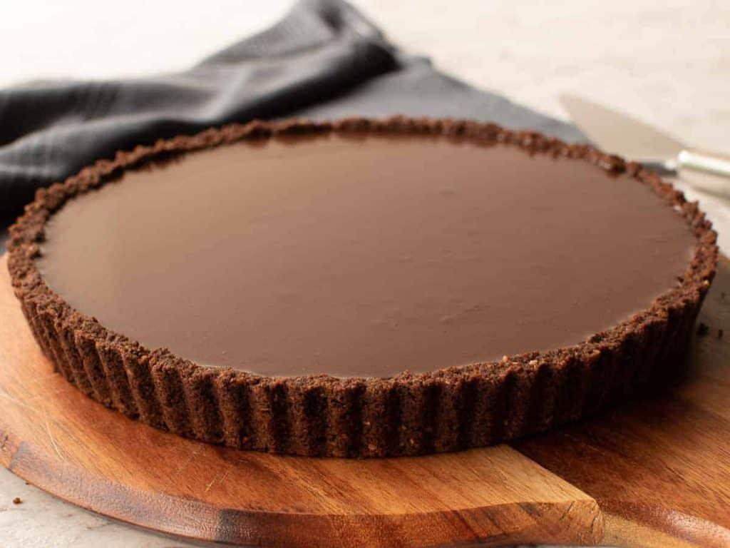 chocolate tart on wooden board