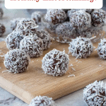Image with text. Text reads Boozy Rum Balls Holiday Entertaining. Image is rum balls on wooden board