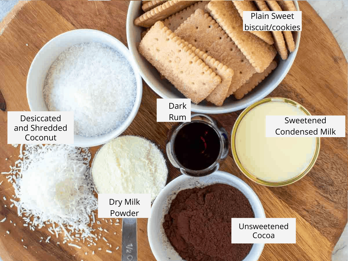 ingredients to make rum balls - biscuits/cookies, cocoa, rum, coconut, milk powder and condensed milk