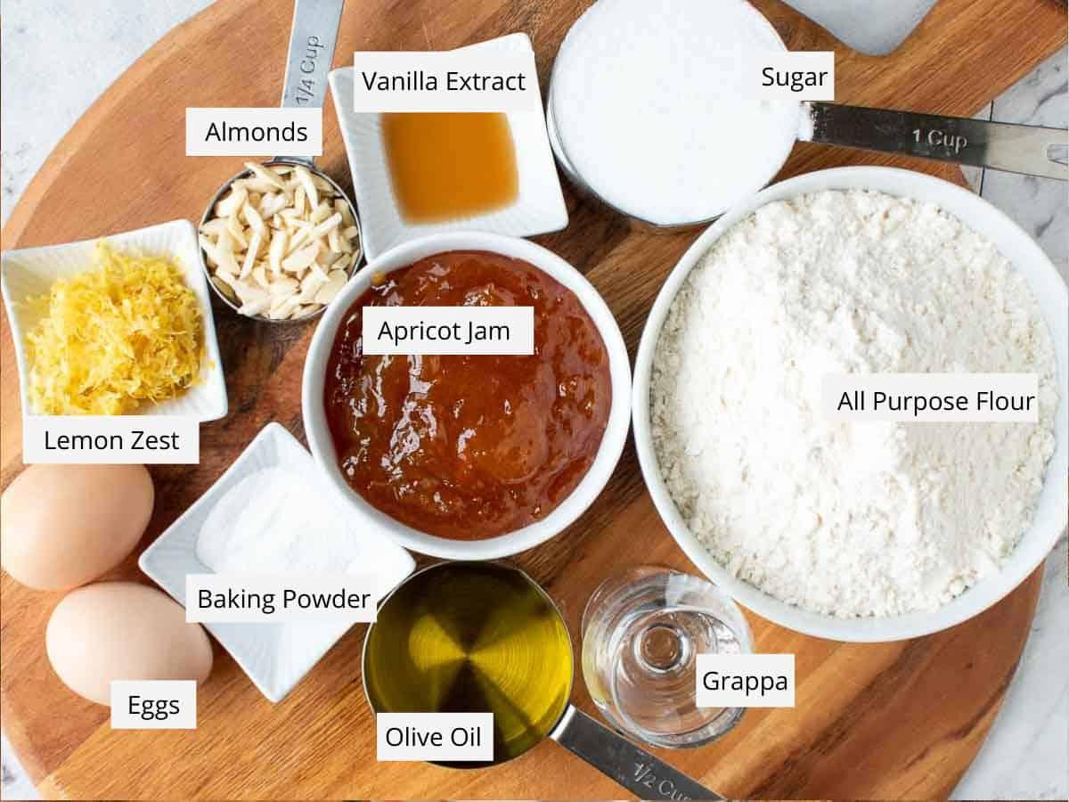 eggs; lemon zest, almonds, vanilla, sugar, flour, grappa, olive oil, baking powder and apricot jam.