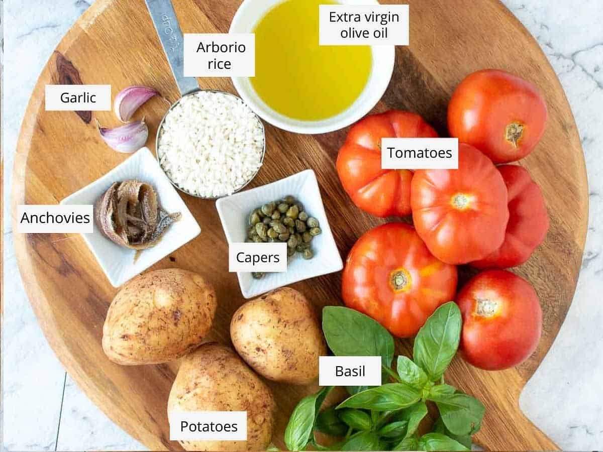 ingredients for stuffed baked tomatoes with rice as in the recipe card.