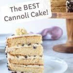 image with text overlay. text read the best cannoli cake. image is slice of cannoli cake on white plate with cannoli cake in background.