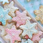pink, white and blue decorated sugar cookies viewed from above.