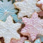 close up of pink, white and blue decorated sugar cookies viewed from above.