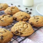 chocolate chip cookies on black wire rack.