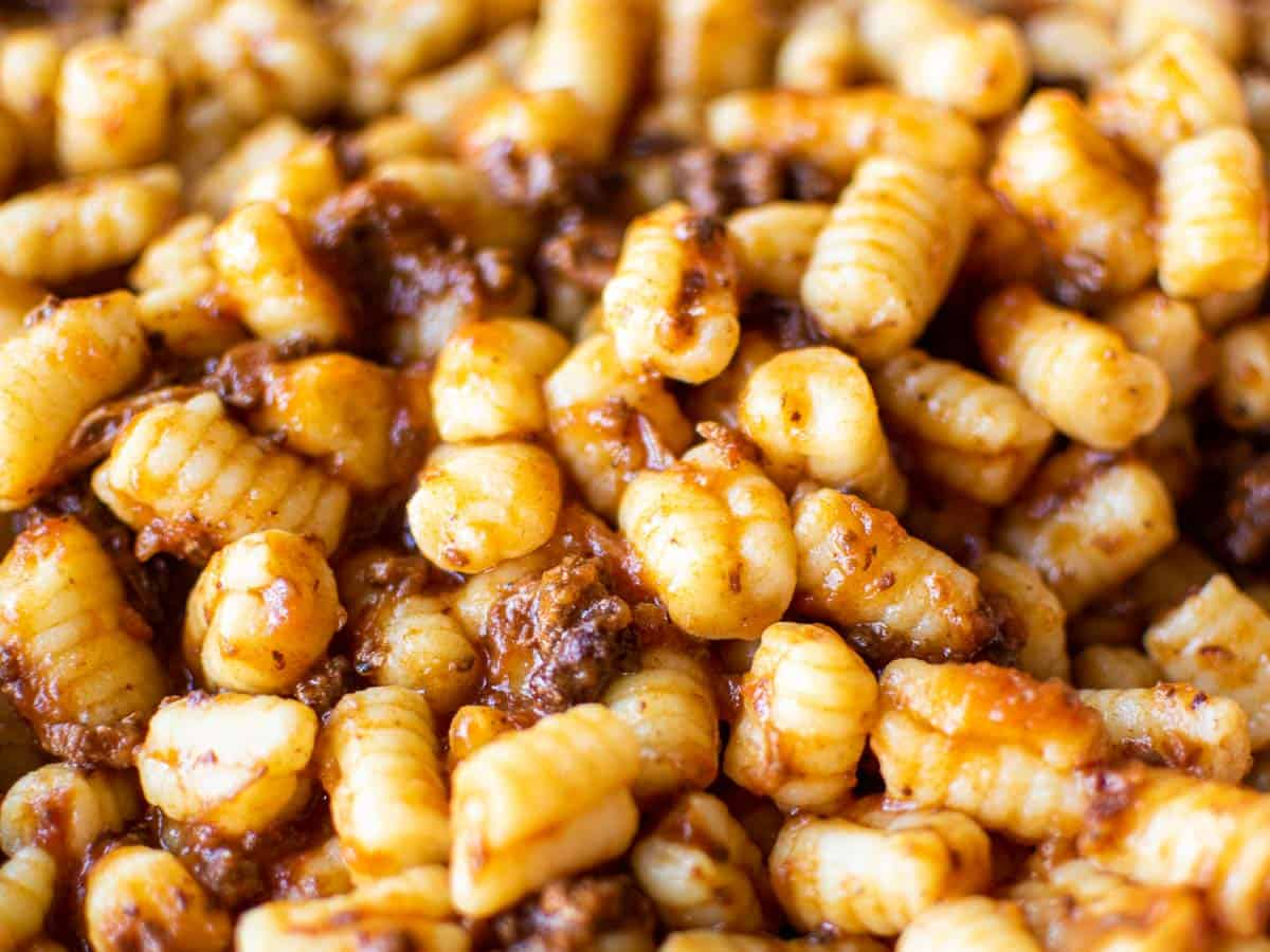 close up of pasta with bolognese sauce.