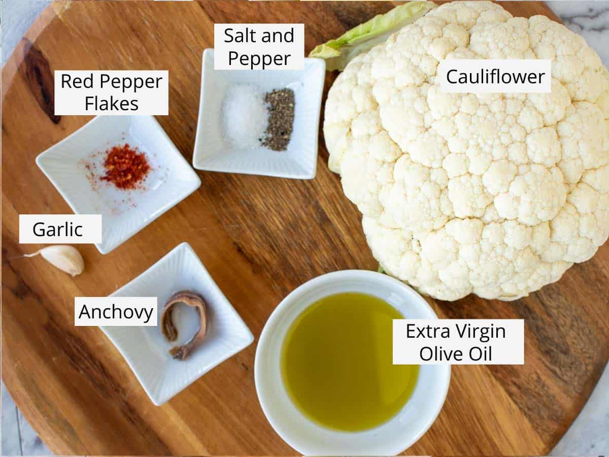 Labelled ingredients laid out on a wooden table.