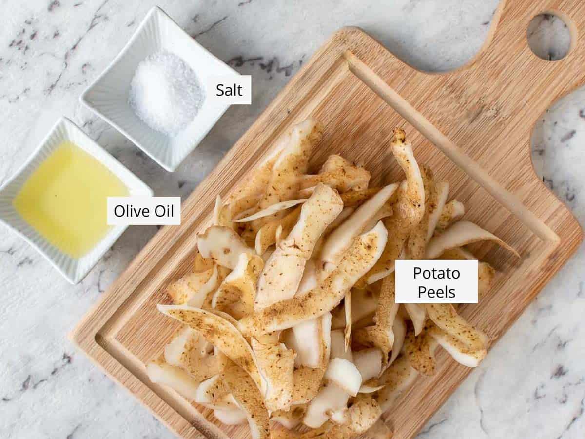 potato peel, salt and oil on wooden board
