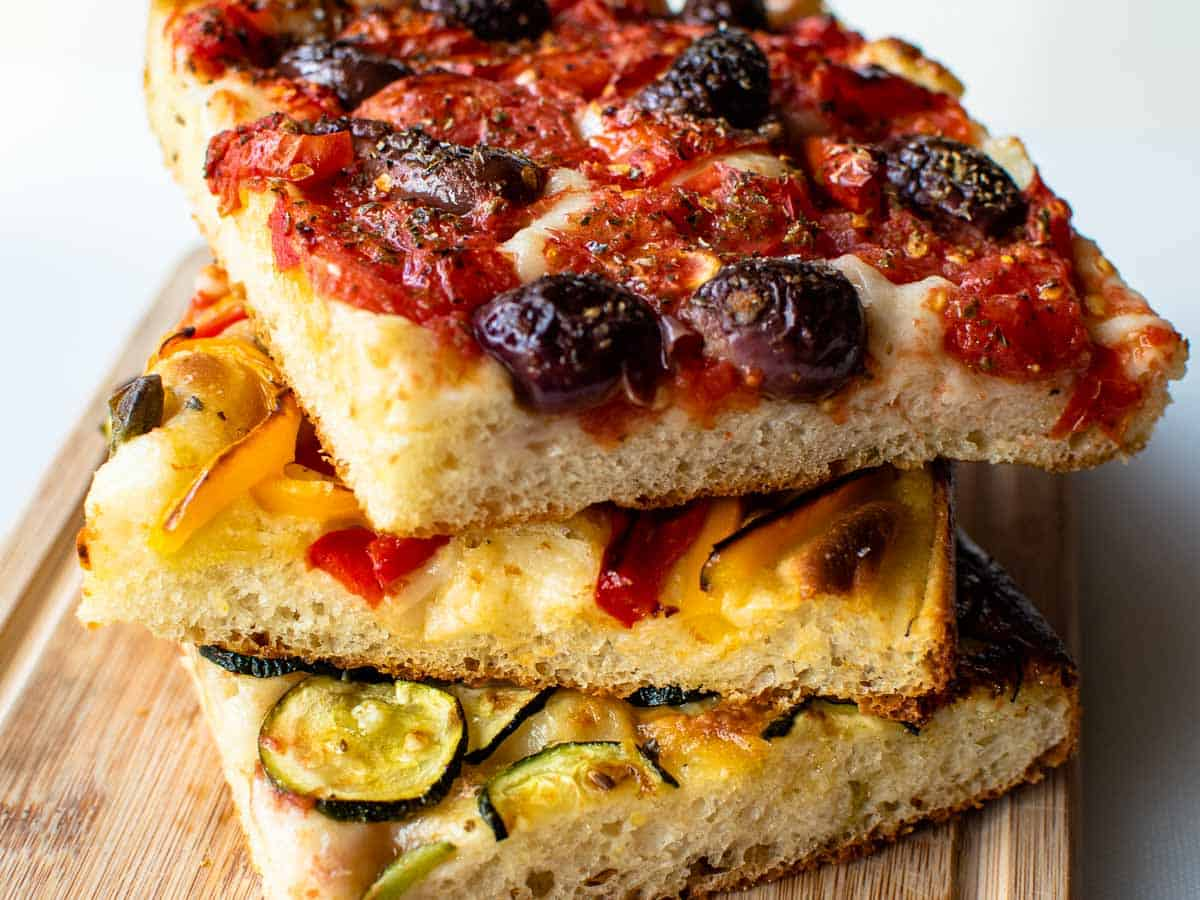 three squares of focaccia bread stacked.